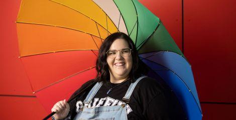 Griffith student holding rainbow umbrella