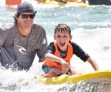 Nick in the surf with kids