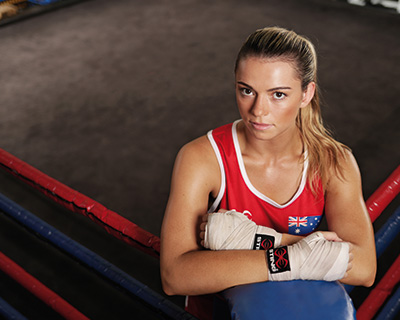 Skye Nicolson standing in the corner of a boxing ring with a determined look on her face
