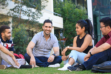 A group of students sitting on grass