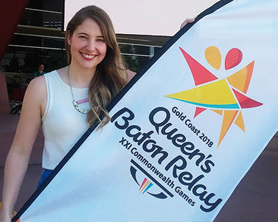 Elise Appelton with her Gold Coast 2018 Queens Batton Relay banner design