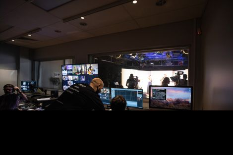 Students and teachers in control room filming