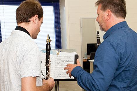 Paul dean teaching a clarinet student