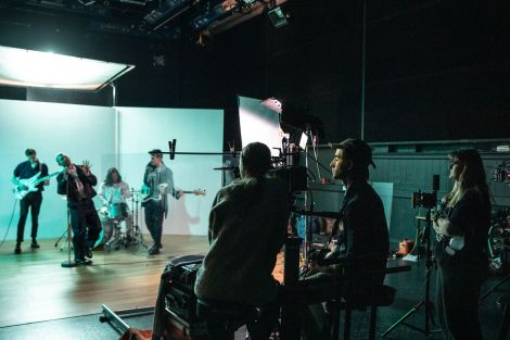Students filming on set