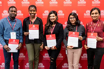 Five students holding their scholarship certificates
