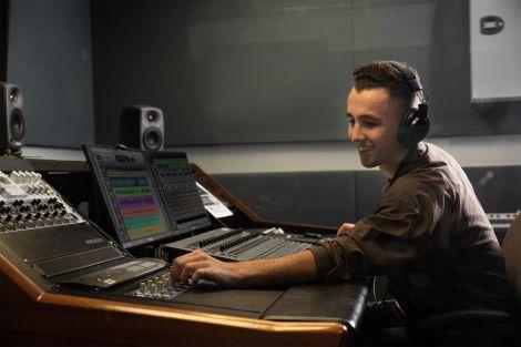 Student in sound recording studio
