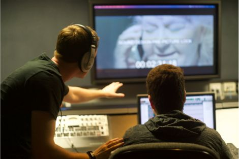 two students working in sound recording studio